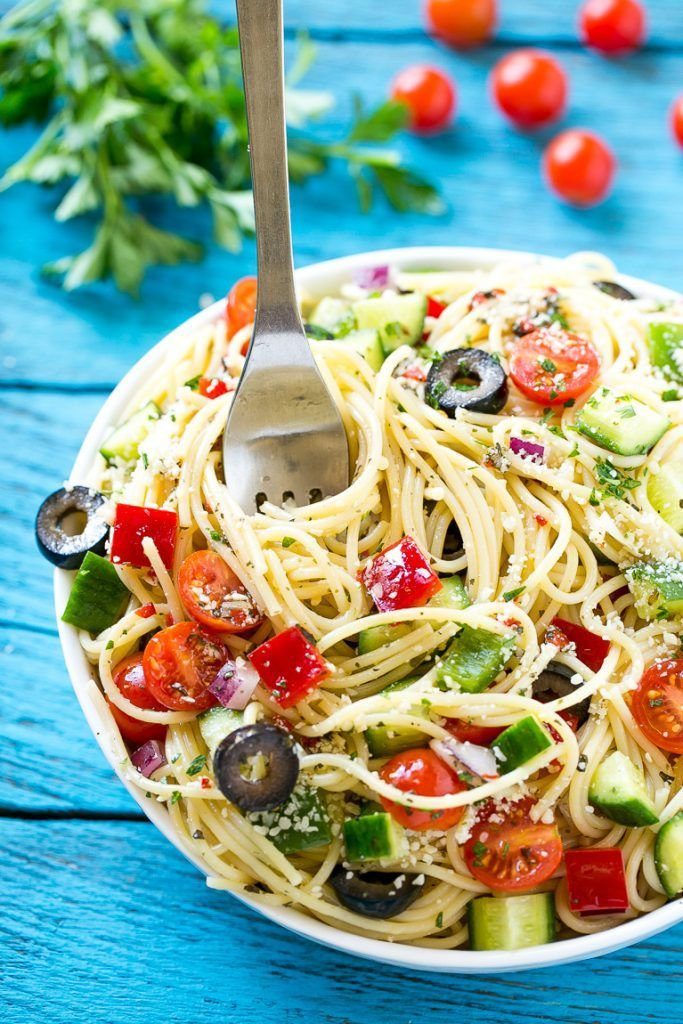 Spaghetti salad with crunchy vegetables, parmesan cheese and homemade zesty Italian dressing