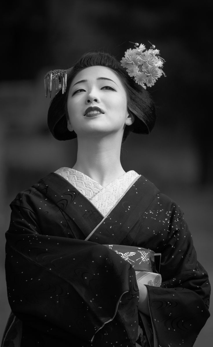 Wow, this by far, one of the loveliest photographs of a geiko I have yet to see. Beautiful expression.