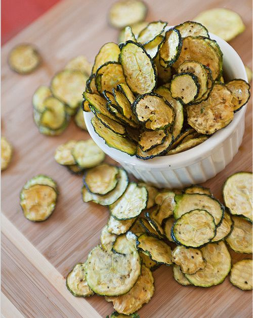 Zucchini Chips ~ thinly sliced zucchini tossed in mixture of salt, pepper, olive oil (optional), apple cider vinegar (to maintain color); place slices on dehydrator tray, dehydrate at 135 degrees F until crispy; store or serve and enjoy