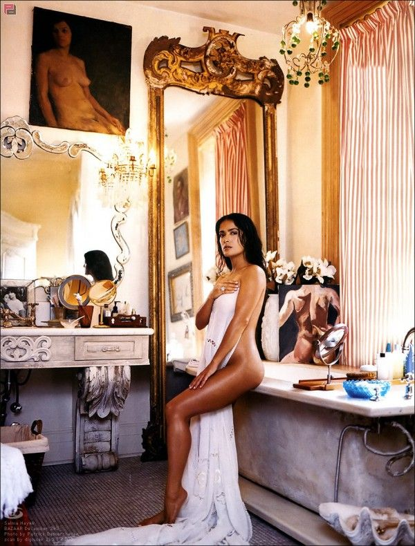 Sexy European Bathroom,Carved Marble Stone tub, Marble Stone vanity, gilded mirror. Old world elegance Salma Hayek by Patrick Demarchelier