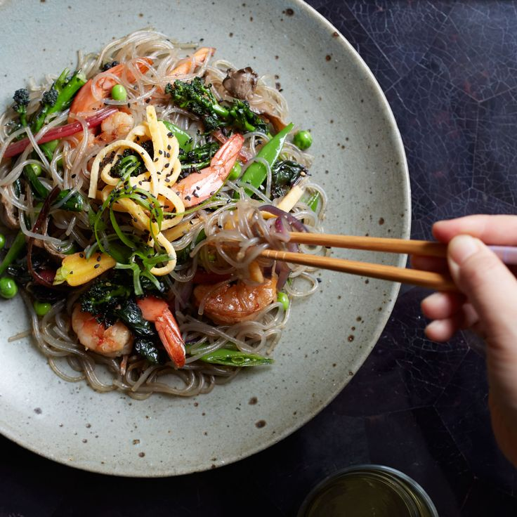 These best-ever stir-fried sweet potato noodles get flavor from shrimp, Broccolini, toasted sesame oil and more. Get the recipe from Food & Wine.