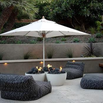Concrete Backyard with Lounge Chairs and Fire Pits