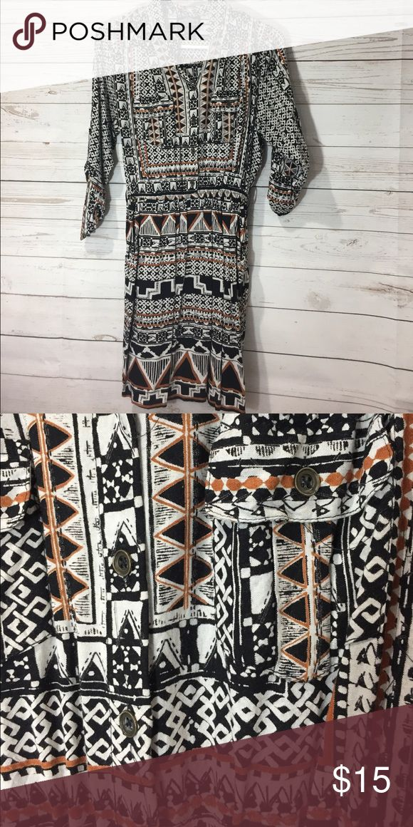 Tribal print dress Worn once! Tribal print dress, buttons up from the waist in front.  Elastic waste. Purchased from haute look. Angie Dresses
