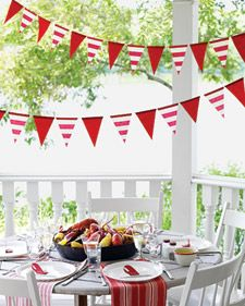 Nothing pulls a party together like a motif and a vibrant palette. Set the tone in advance with claw-shaped invitations. Then use lobster-red and sail-white hues on place cards and festive flag streamers. Striped dish towels serve as napkins -- the generous size is just right for a lobster feast.