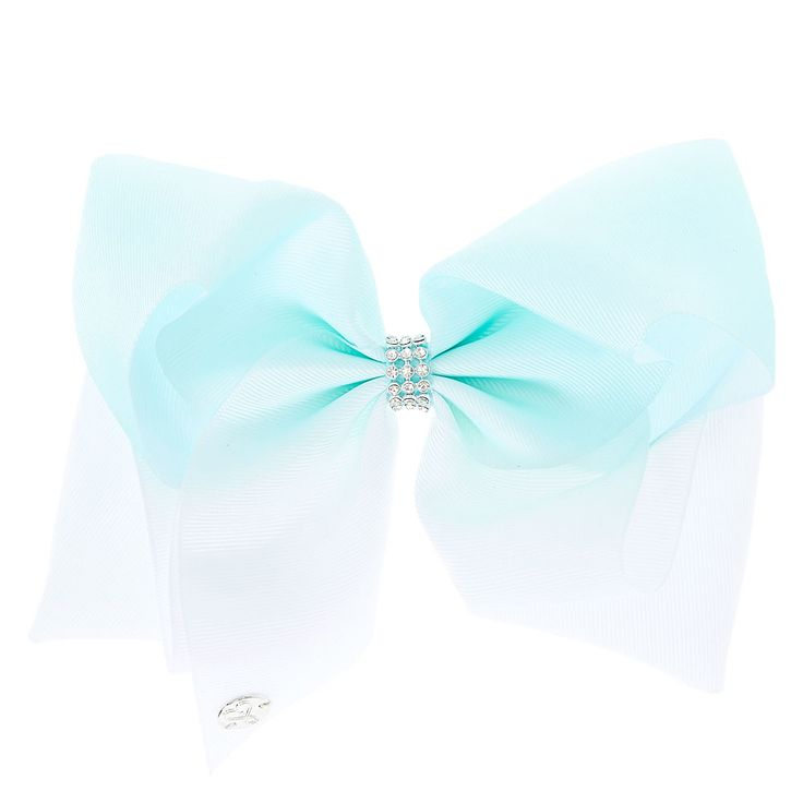 Get the ultimate dancing hair accessory with this super fun large mint & white ombre colored signature hair bow from JoJo Siwa collection. The bow has been attached to a metal salon clip making it really easy to wear and has been covered in rhinestones so you will sparkle from head to toe.<UL><LI>JoJo Siwa collection</LI><LI>Large white & mint ombre design</LI><LI>Metal salon clip</LI></UL><P>The JoJo Si...