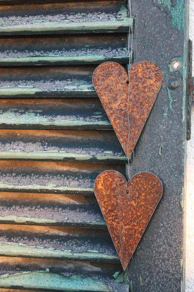 Rusty Hearts...on a green shutter.