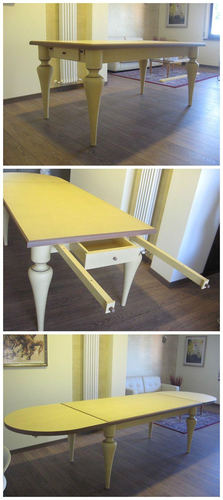Tavolo classico in legno frassino massello con gambe tornite, due cassetti, e supporti estraibili per doppia prolunga ad arco