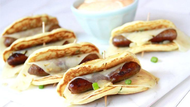 "Blogger Stacey Little from Southern Bite shares a fun twist on the traditional ""pig in a blanket"" with these Spicy Green Onion Pigs in a Blanket with Sriracha Dipping Sauce."