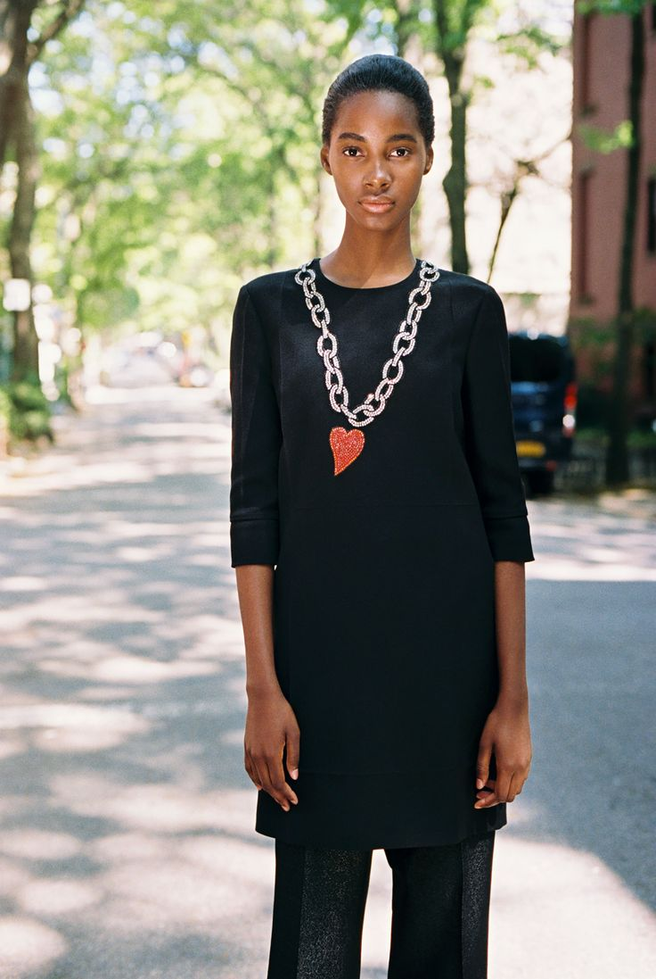 Tami Williams, 18, in a Gucci dress with heart and chain rhinestone appliqué and vintage black trousers.