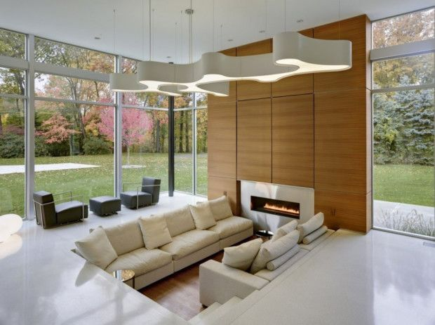 Modern living room of Shaker Heights Residence by Dimit Architects with wood-skinned decoration
