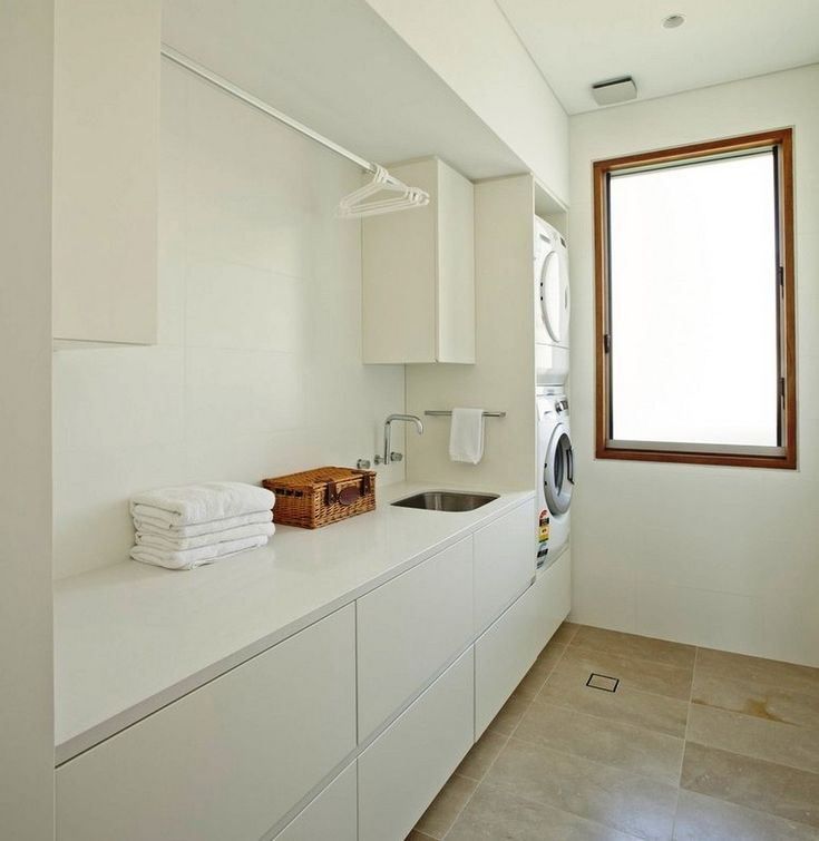 Architecture: Modern Laundry Room Design Ideas With White Sleek Countertop Cabinets And Built In Wash Machine Also Limestone Flooring: Middle Harbour House in Sydney by Richard Cole Architecture