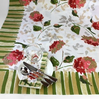 'Hydrangea' tablecloth from the Juniper Hearth e-Emporium. Sturdy cotton with hand block printed floral design in coral pink, red and green. $85.