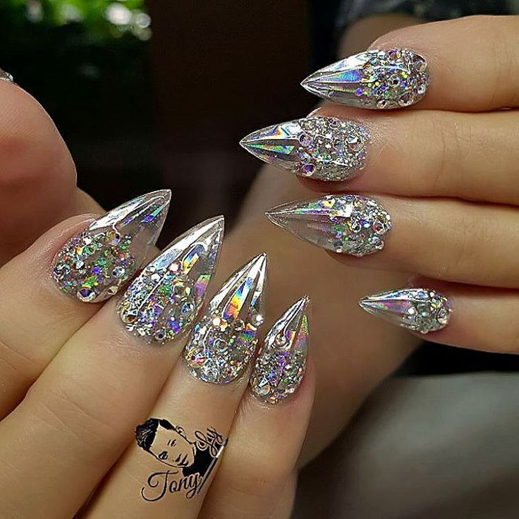 Cinderella nails Holographic Mylar strips, iridescent Swarovski crystals, clear glass gel, almond shape nail design