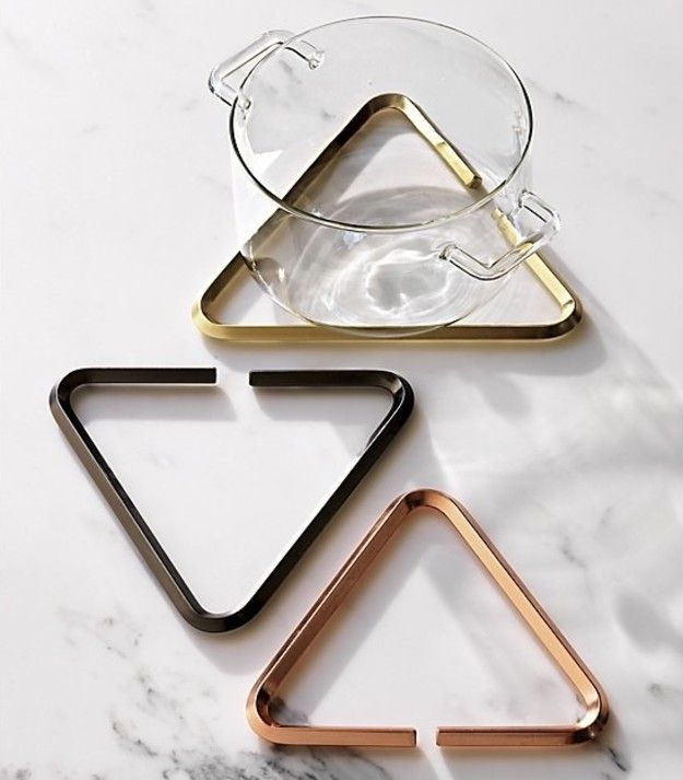 Use a set of modern trivets that double as conversation pieces to protect everyday surfaces from hot plates. | 22 Lazy Ways To Throw A Dinner Party