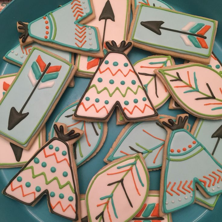 Woodland tribal  first birthday party. Teepee cookies. Arrow cookies. Feather cookies.