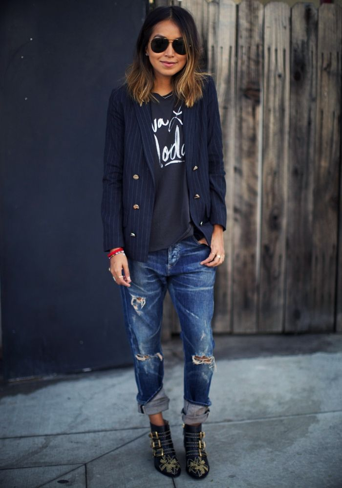 Shop this look on Lookastic:  http://lookastic.com/women/looks/crew-neck-t-shirt-sunglasses-double-breasted-blazer-boyfriend-jeans-ankle-boots/8326  — Charcoal Print Crew-neck T-shirt  — Black Sunglasses  — Navy Vertical Striped Double Breasted Blazer  — Navy Ripped Boyfriend Jeans  — Black Studded Leather Ankle Boots