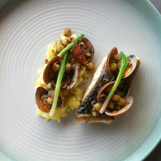 "Seasonal cuisine of Plantation Restaurant Alila (Ubud - Bali) Barramundi Pan-fried barramundi served with Manilla, clams in ""beurre noisette"" vinaigrette, chopped cauliflower, young green onions, cashew nuts and crushed young potatoes"