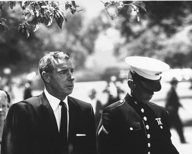 Joe Di Maggio and Joe Di Maggio Jr. at Marilyn Monroe's funeral, 1962  by Lawrence Schiller photographer