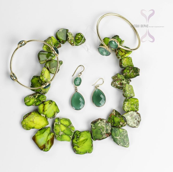 green pieces of jewelry by ADMK