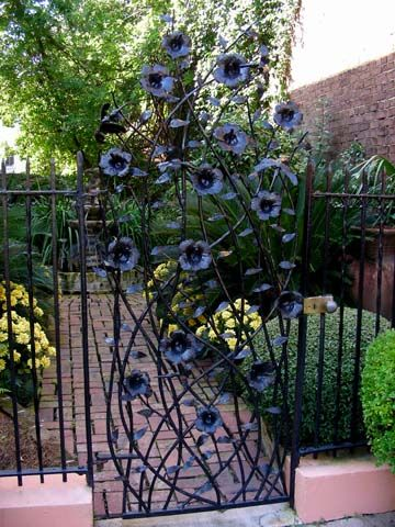 Inspirational Factors  -peaceful  -welcoming  -open  -modern with an old twist  The idea behind this is creative it's like an iron gate mixed with the garden behind the iron gates.