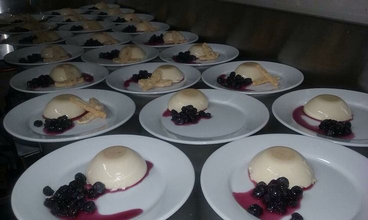 Preparing Honey & Lavender Panna Cottas with Poached Blueberries for the opening night of a restaurant