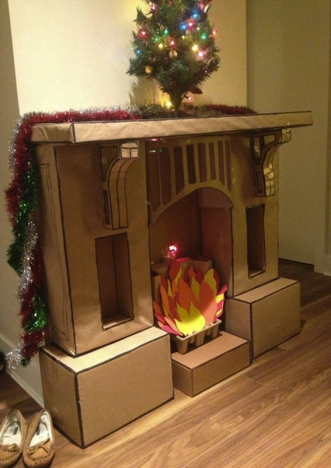 Cardboard Fireplace.  Pinning for the next time we need a stage fireplace!!