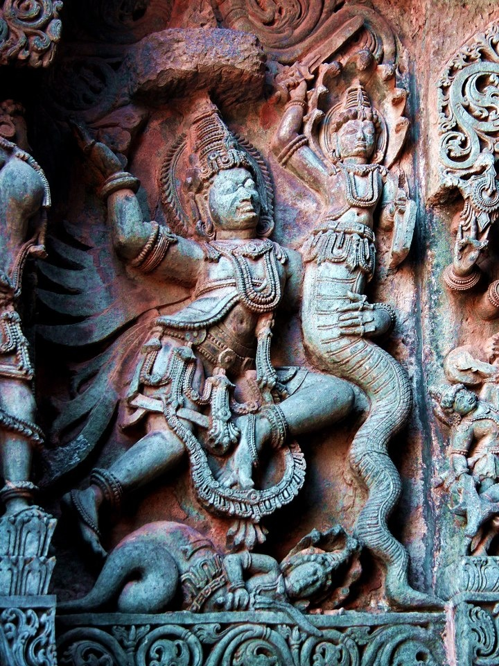 Garuda fights the snakes. Garuda, who as a bird is the traditional enemy of snakes, fights a pair of nagas.    Hoysaleshvara Temple, Halebid, India.Garuda