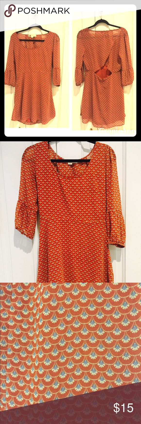 Size L Festival Open back Rust Dress Have worn this dress only 2 times but clearing out my closet. In perfect condition. It's the perfect festival dress and has a peek a boo / open back for that blissful breeze during a hot day at a music festival! It's a gorgeous rust color and playful pattern, due to its color tone, it can definitely be worn in any season! one clothing Dresses Mini