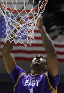 Akeem Richmond, whose 3-pointer at the buzzer won the CIT tournament title cuts down the net in Ogden, Utah last April