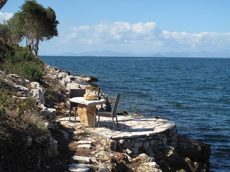 A small stone table in the seafront