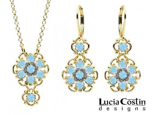 Lucia Costin 14K Yellow Gold over .925 Sterling Silver Pendant and Earrings Set with Twisted Lines and Sterling Silver 6 Petal Central Flowers, Garnished with Dots and Light Blue Swarovski Crystals; Handmade in USA Lucia Costin. $118.00. Lucia Costin jewelry set. Embellished with aquamarine Swarovski crystals. Feminine floral design. Produced delicately by hand, made in USA. Unique and feminine, perfect to wear for special occasions and evenings
