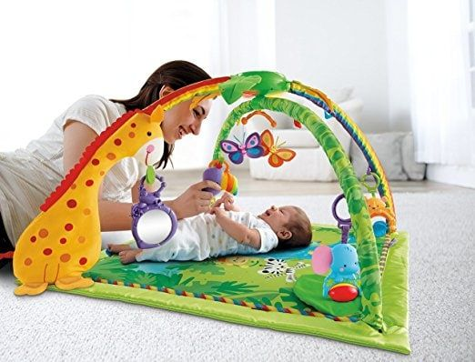 Fisher-Price Rainforest Melodies and Lights Deluxe Gym Bring the rainforest to life with music, lights and nature sounds that respond to baby's movement. Linkable toys, busy activities and a soft mat make lay & play and tummy time so much fun!