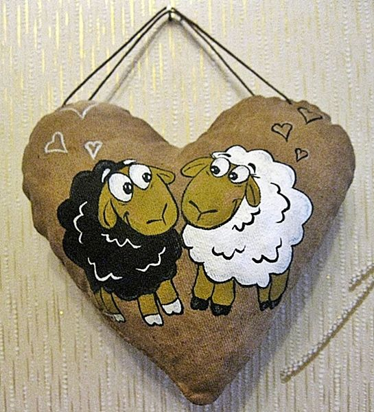 Add a smaller heart at the bottom and put baby sheep.