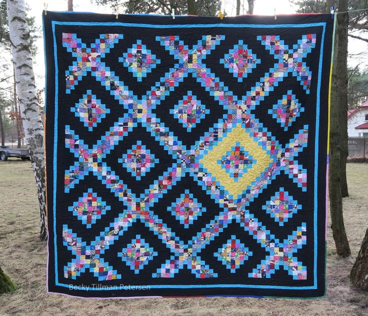 """Top finishes at 95.5"""" x 95.5"""" You need: * About 6 yards of various scraps in order to cut 2"""" squares from * 5 3/8 yards of black * 2 1/8 yards of bright blue for the chain and outlining effect and inner border * 3/8 yard of bright yellow * ½-5/8 yard of fabric fo"""