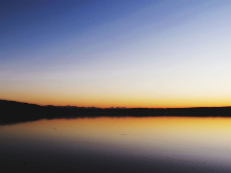 reflection, tranquility, tranquil scene, scenics, beauty in nature, nature, water, sunset, lake, idyllic, outdoors, silhouette, no people, sky, waterfront, clear sky, travel destinations, landscape, view into land, day