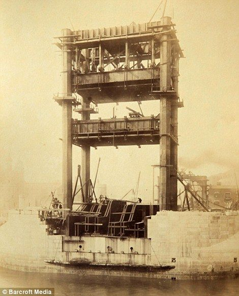 Here's London's famous Tower Bridge being built. Odd to see it without any of the trimmings we've come to recognise.