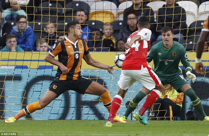 Jake Livermore blocked Arsenal midfielder Francis Coquelin's shot at goal, with…
