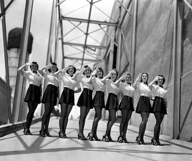 These alluringly lovely 1940s chorus line girls are definitely worth saluting back! :)