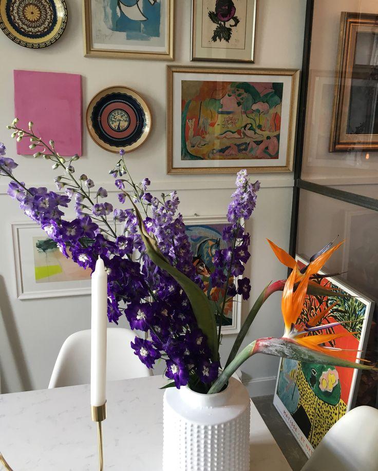 Colourful flowers and art wall. Helene Hammer