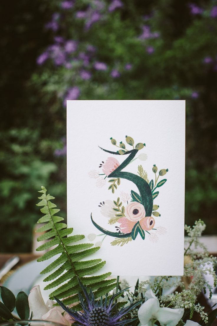A Boho Backyard Wedding Full of Romance--painted table numbers