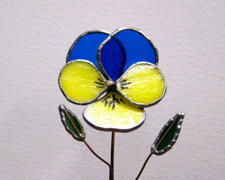 Pansy in a Bottle in Cobalt Blue and Yellow 3D stained glass. $25.00, via Etsy.                                                                                                                                                                                 More