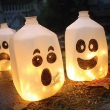 We make faces for pumpkins, why not ghosts? These are empty milk gallons with ghosty faces and have a fiery touch.
