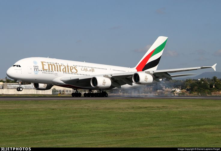 Emirates 701 from Dubai is landing on runway 14.. A6-EEX. Airbus A380-861. JetPhotos.com is the biggest database of aviation photographs with over 3 million screened photos online!