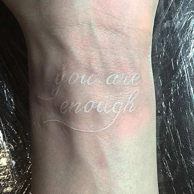 "White Ink Wrist Tattoo - ""You Are Enough""                                                                                                                                                      More"