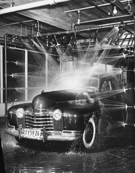 Vintage pic of an Olds being run thru an automatic car wash