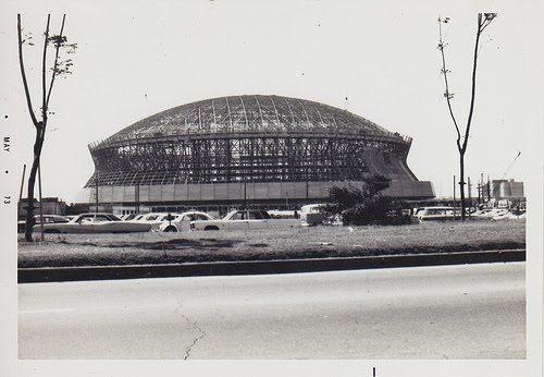 """""""Construction of the Louisiana Superdome began in 1971. It was finally finished behind schedule in August 1975, 7 months after Super Bowl IX had been scheduled to be played in it. The final cost of building the Superdome came to $ 165 million, almost 4 times the initial budget. There was some controversy surrounding the building of the Dome on the site of the former Girod Street Cemetary, with some even going as far as labeling the Dome as permanently haunted."""""""