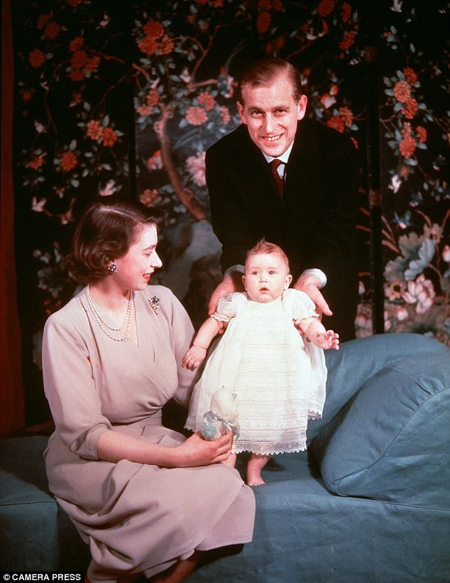 The baby Prince Charles is seen here in the arms of his mother Princess Elizabeth in 1949