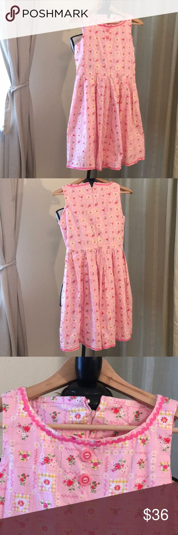 New Handmade Pink Flower Pattern Dress This new never been worn handmade pink flower pattern dress is sleeveless with a rounded neckline and uniform pleats in the skirt. 2 pink buttons in front w/ pink decor. Zipper in back. Bust: approx 34 inches. Waist: approx 39 inches. Shoulder to waist: approx 14.5 inches. Waist to bottom hem: 21 inches. 100% cotton. Machine wash in cold. Air dry. Big Girls XL. Enjoy wearing a one of a kind dress💖 Hand Made Dresses
