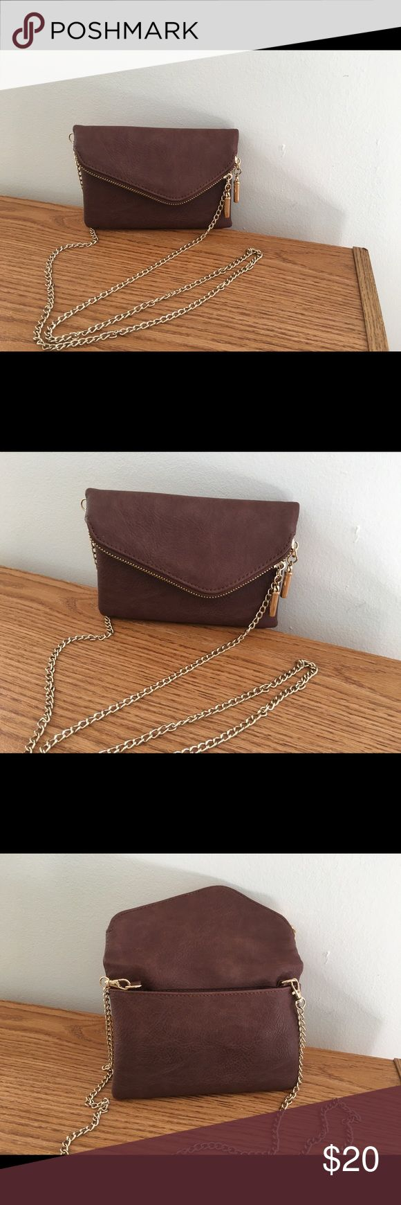 Leather evening bag Lighter brown leather evening or casual bag. This has a flap that folds down and has a double zipper on top of flap. When you fold the flap down it has a magnetic closure that holds the flap down. Has gold hardware. This is. Very cute bag.  The strap is a gold chain. Bags Cosmetic Bags & Cases