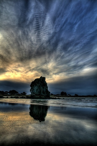 Shag Rock, Sumner, New Zealand.  This volcanic formation has since been erased by an earthquake.